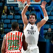 Anadolu Efes's Kerem TUNCERI (R) during their Turkish Basketball League match Anadolu Efes between Banvit at Arena in Istanbul, Turkey, Sunday, November 06, 2011. Photo by TURKPIX