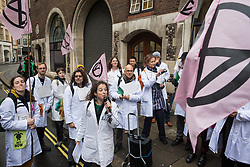 London, UK. 22 November, 2019. Dr Emily Grossman addresses climate activists from Scientists for XR outside the Department for Education during a demonstration intended to communicate the science relating to the climate and ecological emergency. Activists were dressed in labcoats to represent the 1600 scientists worldwide who have signed the Scientists Declaration in support of non-violent direct action against government inaction against the climate and ecological emergency.