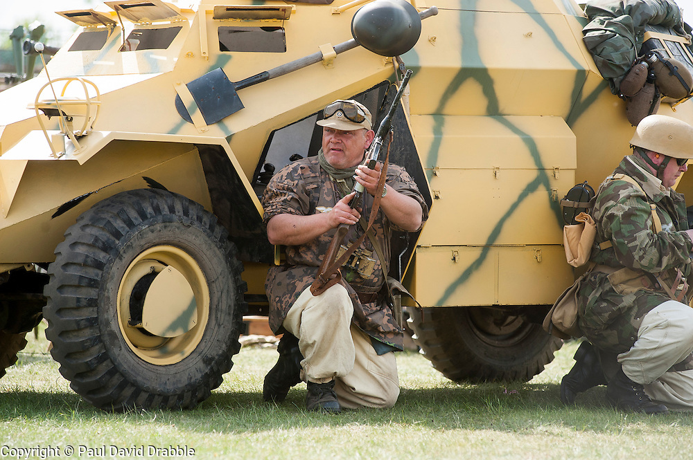 """Reenactor of the NWW2A Portraying a member of the """"Green Devils"""" beside a 222 reconnaissance vehicle during a battle reenactment at Fort Paull on Bank Holiday Monday..5 May 2013.Image © Paul David Drabble"""