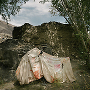Motorcycle wrapped in cloth. The traditional life of the Wakhi people, in the Wakhan corridor, amongst the Pamir mountains.