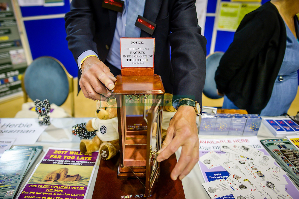 """A man opens a toy closet declaring """"There are no racists inside or outside this closet"""" at the Ukip annual conference, Bournemouth."""