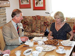 File photo dated 12/07/05 of the Duchess of Cornwall and the Prince of Wales visiting Cwm Berem Farm, Dyfed. Charles and Camilla are celebrating their 15th wedding anniversary on Friday, after they were reunited on Monday when the 72-year-old duchess came out of a 14-day self-isolation on the Balmoral estate in Aberdeenshire.