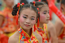 September 13, 2016 - Pingchang, China - A group of young dancers at the finish line of the fourth stage, 157.57 km from Bazhong to Pingchang, during the 2016 Tour of China 1...On Tuesday, 13 September 2016, in Pingchang, China. (Credit Image: © Artur Widak/NurPhoto via ZUMA Press)