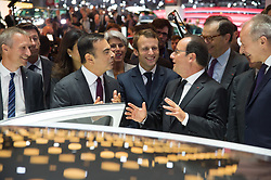 French President Francois Hollande (C) speaks as he tours the stand for French car manufacturer Renault with CEO of Nissan-Renault Carlos Ghosn (3-R) and French Minister of Economy, Industrial Renewal and Information Technology Emmanuel Macron (4-R) during an official visit to the Paris Motor Show 'Mondial de l'Automobile' in Paris, France, 03 October 2014. The Paris Motor Show, which takes place every two years, runs from 04 to 19 October 2014 with international car makers presenting their latest models and studies. Photo by Villard/Pool/ABACAPRESS.COM