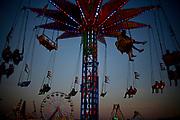 "William DeShazer/Staff<br /> Fair goers ride ""Skyflyer"" during the Collier County Fair on Friday March 15, 2013. The Collier County Fair runs through March 24."