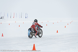 Bene Zaccherini of Italy taking another pass on the ice on her spiked Husqvarna WR 360 on the 1/8 mile qualifying track at the Baikal Mile Ice Speed Festival. Maksimiha, Siberia, Russia. Thursday, February 27, 2020. Photography ©2020 Michael Lichter.
