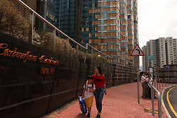 September 30, 2018 - Hong Kong, CHINA - HARBOURFRONT LANDMARK, a high class residential complex suffered severe damage to the windows during Super Typhoon Mangkhut that ravaged Hong Kong with fierce force exactly a week ago. Broken windows are now temporarily fixed with wooden boards awaiting further damage assessments and repair. Sept-30,2018 Hong Kong.ZUMA/Liau Chung-ren (Credit Image: © Liau Chung-ren/ZUMA Wire)