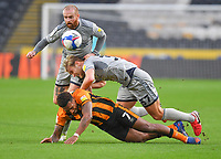 Hull City's Mallik Wilks is fouled by  Burton Albion's Sam Hughes<br /> <br /> Photographer Dave Howarth/CameraSport<br /> <br /> The EFL Sky Bet League One - Hull City v Burton Albion - Saturday 14th November 2020 - KCOM Stadium - Kingston upon Hull<br /> <br /> World Copyright © 2020 CameraSport. All rights reserved. 43 Linden Ave. Countesthorpe. Leicester. England. LE8 5PG - Tel: +44 (0) 116 277 4147 - admin@camerasport.com - www.camerasport.com