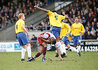 Photo: Steve Bond.<br />Scunthorpe United v Nottingham Forest. Coca Cola League 1. 10/03/2007. Wes Morgan (right) out battles Jermaine Beckford (Left)
