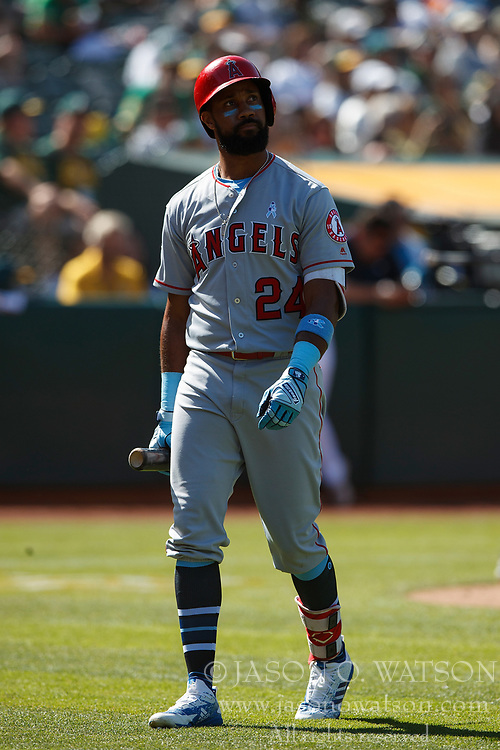 OAKLAND, CA - JUNE 17: Chris Young #24 of the Los Angeles Angels of Anaheim returns to the dugout after striking out against the Oakland Athletics during the eleventh inning at the Oakland Coliseum on June 17, 2018 in Oakland, California. The Oakland Athletics defeated the Los Angeles Angels of Anaheim 6-5 in 11 innings. (Photo by Jason O. Watson/Getty Images) *** Local Caption *** Chris Young