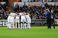 Swansea city players get in a group huddle ahead of k/o. Barclays Premier league match, Swansea city v West Ham Utd at the Liberty Stadium in Swansea, South Wales  on Sunday 20th December 2015.<br /> pic by  Andrew Orchard, Andrew Orchard sports photography.
