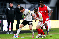 Jason Knight of Derby County holds off pressure from Ben Wiles of Rotherham United - Mandatory by-line: Ryan Crockett/JMP - 16/01/2021 - FOOTBALL - Pride Park Stadium - Derby, England - Derby County v Rotherham United - Sky Bet Championship