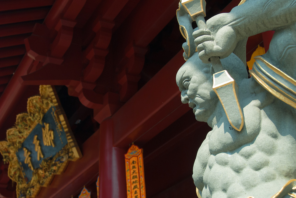 Statue guarding entrance to Buddha Tooth Relic Temple, Singapore.