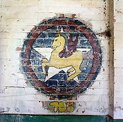 WW2 unicorn emblem painting at the former Flixton air force base in Suffolk, England. Flixton was a former airfield located around 3 miles (4.8 km) south-west of Bungay and home  to the 706th Bombardment Squadron, an operational squadrons of the USAAF's 446th Bombardment Group (Heavy). The 446th operated chiefly against strategic objectives on the Continent from December 1943 until April 1945. Targets included U-boat installations at Kiel, the port at Bremen, a chemical plant at Ludwigshafen, ball-bearing works at Berlin, aero-engine plants at Rostock, aircraft factories at Munich, marshalling yards at Coblenz, motor works at Ulm, and oil refineries at Hamburg. After the war, the buildings reverted to agricultural and industrial use.