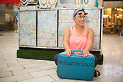Classic Loot owner and designer Tam Tran poses for a portrait in her pop-up stand at Westfield Valley Fair Mall in San Jose, California, on July 29, 2014. (Stan Olszewski/SOSKIphoto for Content Magazine)