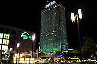 Berlin, Germany. Alexanderplatz at night. Galeria Kauphof shopping mall and Park Inn hotel.