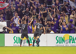April 21, 2018 - Orlando, FL, U.S. - ORLANDO, FL - APRIL 21: Orlando City forward Chris Mueller (17) celebrates his goal with the fans during the MLS soccer match between the Orlando City FC and the San Jose Earthquakes at Orlando City SC on April 21, 2018 at Orlando City Stadium in Orlando, FL. (Photo by Andrew Bershaw/Icon Sportswire) (Credit Image: © Andrew Bershaw/Icon SMI via ZUMA Press)