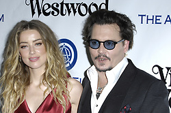 May 26, 2016 - File - AMBER HEARD has filed for divorce from JOHNNY DEPP after just 15 months of marriage amid claims his family hated her. The actress, 30, submitted court documents on Monday citing irreconcilable differences and seeking spousal support, triggering a battle over the star's 00 million fortune. Depp, 52, is father to 16-year-old Lily-Rose Depp and 14-year-old Jack Depp. His mom, Betty Sue Palmer, died just three days before Heard signed a petition for divorce Monday. Pictured: Jan. 10, 2016 - Culver City, CA, UNITED STATES OF AMERICA - Amber Heard and Johnny Depp during The Art of Elysium's Ninth Annual Heaven Gala held at 3LABS, on January 9, 2016, in Culver City, California..Photo: Michael Germana Star Max  (Credit Image: © Starmax/Newscom via ZUMA Press)