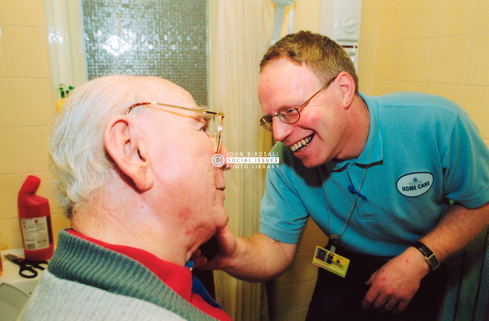 Home helper caring for elderly man in sheltered accommodation Bradford Yorkshire UK