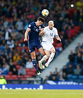 Football - 2018 / 2019 UEFA European Championship Qualifier - Group I: Scotland vs. Cyprus<br /> <br /> Scott McKenna of Scotland vies with Andreas Makris of Cyprus during the European Championship Qualifying match between Scotland and Cyprus, at Hampden Park, Glasgow.<br /> <br /> COLORSPORT/BRUCE WHITE