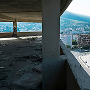 MOSTAR, BOSNIA AND HERZEGOVINA - JUNE 28:  A derelict building damaged during the 1993 war is seen from an onl sniper position on June 28, 2013 in Mostar, Bosnia and Herzegovina. The Siege of Mostar reached its peak and more cruent time during 1993. Initially, it involved the Croatian Defence Council (HVO) and the 4th Corps of the ARBiH fighting against the Yugoslav People's Army (JNA) later Croats and Muslim Bosnian began to fight amongst each other, it ended with Bosnia and Herzegovina declaring independence from Yugoslavia.  (Photo by Marco Secchi/Getty Images)