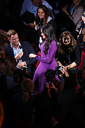 The Duchess of Sussex is welcomed on stage during the opening ceremony of the One Young World summit at the Royal Albert Hall, London.