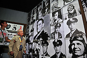 """KUNMING, CHINA - SEPTEMBER 06: (CHINA OUT)<br /> <br /> Flying Tiger Veterans Visit The Cultural Relics Exhibition Of The Flying Tigers In Kunming<br /> <br /> A Flying Tiger veteran visits The Cultural Relics\' Exhibition of the \""""Flying Tigers\"""" at Kunming Museum on September 6, 2015 in Kunming, Yunnan Province of China<br /> <br /> The 1st American Volunteer Group (AVG) of the Chinese Air Force in 1941–1942, nicknamed the Flying Tigers, was composed of pilots from the United States Army Air Corps (USAAC), Navy (USN), and Marine Corps (USMC), recruited under presidential authority and commanded by Claire Lee Chennault. The shark-faced nose art of the Flying Tigers remains among the most recognizable image of any individual combat aircraft or combat unit of World War II.<br /> ©Exclusivepix Media"""