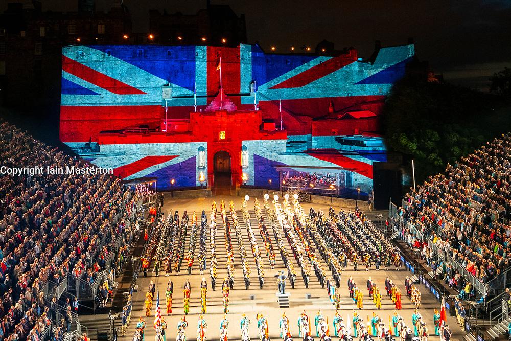 Large Union flag projected onto Edinburgh Castle during Edinburgh International Tattoo part of Edinburgh International Festival 2018 in Edinburgh, Scotland, UK