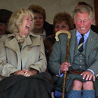 Prince Charles and Camilla laugh while watching the Mey Highland games.David Cheskin.Press Association.