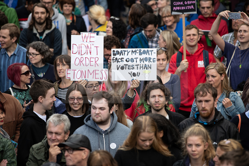 """© Licensed to London News Pictures. 31/08/2019. Manchester, UK. Placards reading """" We didn't order Eton Mess """" and """"Boaty McBoatface got more votes than you """" . Thousands attend a pro EU demo in Manchester City Centre and march en masse along John Dalton Street to join an Extinction Rebellion occupation of Deansgate . Objections are being raised about the Prime Minister Boris Johnson's intention to prorogue Parliament in the run up to Britain's planned Brexit deadline . Photo credit: Joel Goodman/LNP"""
