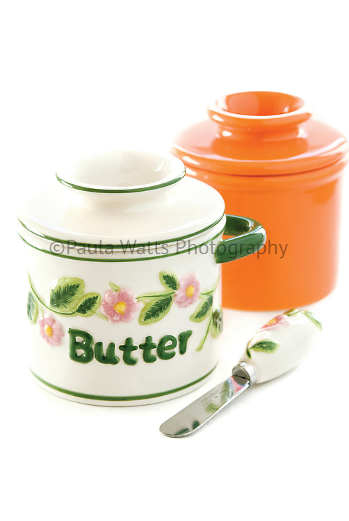 butter jars on white background
