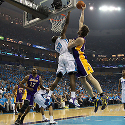 April 28, 2011; New Orleans, LA, USA; Los Angeles Lakers power forward Pau Gasol (16) shoots over New Orleans Hornets center Emeka Okafor (50) during the first quarter in game six of the first round of the 2011 NBA playoffs at the New Orleans Arena.    Mandatory Credit: Derick E. Hingle