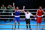 Afanasev Kirill of Ireland (left) celebrates beating Begadze Nikoloz of Georgia in the Men's Heavyweight preliminary during The Road to Tokyo European Olympic Boxing Qualification, Sunday, March 15, 2020, in London, United Kingdom. (Mitchell Gunn-ESPA-Images/Image of Sport)