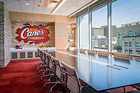 Located on the eighth-floor of the downtown Baton Rouge IBM building, the 6,500 sq. ft. Raisng Canes Corporate office includes the Caniac Conference room with views of downtown Baton Rouge.