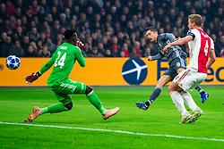 12-12-2018 NED: Champions League AFC Ajax - FC Bayern Munchen, Amsterdam<br /> Match day 6 Group E - Ajax - Bayern Munchen 3-3 / Robert Lewandowski #9 of Bayern Munich scores the 1-0. Andre Onana #24 of Ajax, Matthijs de Ligt #4 of Ajax come too late