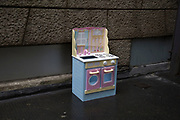 Childs toy kitchen discarded on the street in London, England, United Kingdom.