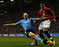 Photo: Javier Garcia/Digitalsport<br /> 07/11/2004 Manchester United v Manchester City, FA Barclays Premiership, Old Trafford<br /> Manchester City's Danny Mills tries his best to deny Christiano Ronaldo