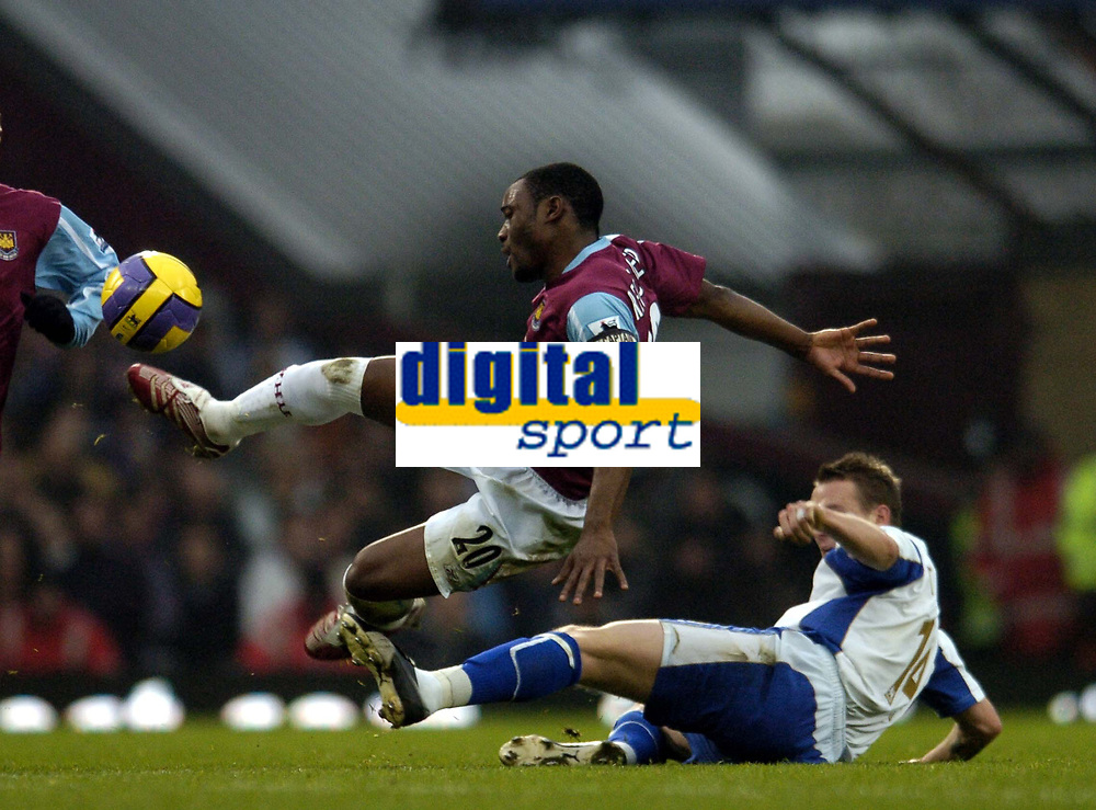 Photo: Olly Greenwood.<br />West Ham United v Portsmouth. The Barclays Premiership. 26/12/2006. West Ham's Nigel Reo Coker tackled by Portsmouth's Matthew Taylor