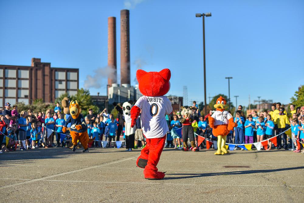 Orbit, mascot for the Akron RubberDucks, entertaining at the Kids Fun Run.