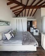 Interior of a loft, comfortable bedroom with bathroom, modern design