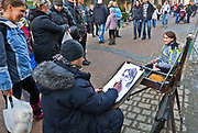 Zakopane, 07/02/2011. Uliczny portrecista na Krupówkach.