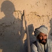 The shadows of Canadian soldiers from the Royal Canadian Regiment (RCR) are cast on the wall by an Afghan farmer who is questioned at a checkpoint during an operation targeting insurgents in the village of Chalghowr in Panjwa'i (Panjwaii) District, Kandahar Province, Afghanistan. <br /> The Canadian Press Images/Louie Palu<br /> CANADIAN SALES AND USE ONLY. NO INTERNATIONAL SALES OR USE.<br /> June 21, 2010