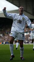 Photo. Andrew Unwin<br />Leeds United v Blackburn Rovers, Barclaycard Premier league, Elland Road, Leeds 04/10/2003.<br />Leeds' Seth Johnson celebrates scoring his team's first goal.