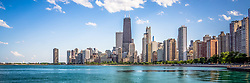 Panorama photo of Chicago skyline. Panoramic photo ratio is 1:3 and includes Chicago lakefront downtown city buidlings on the Near North Side. The John Hancock Center Building is a famous part of the Chicago skyline and is one of the tallest skyscrapers in the world.