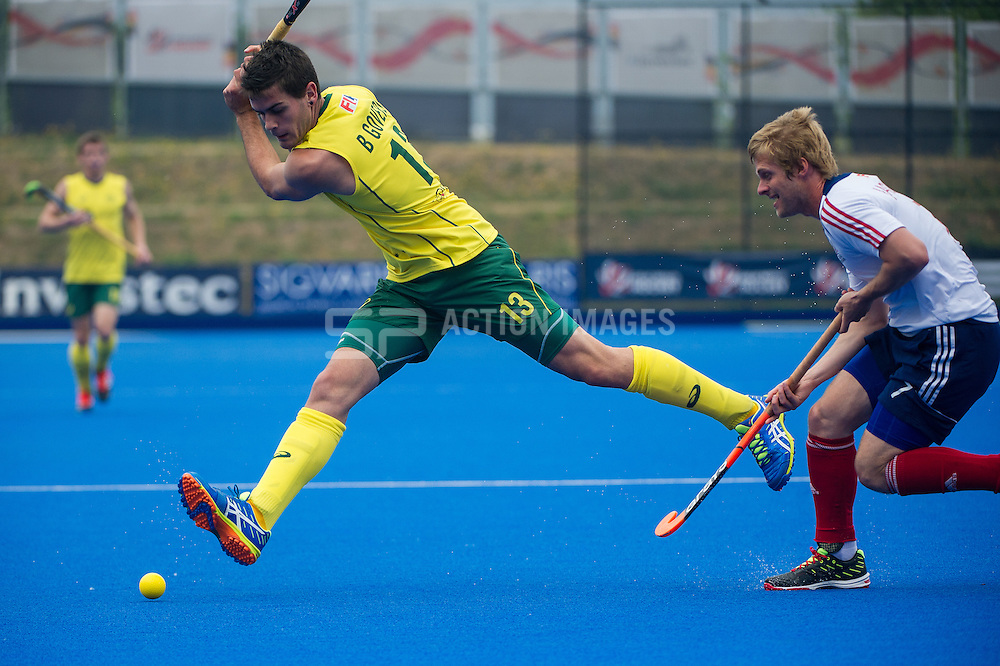 Australia's Blake Govers prepares to cross the ball while watched by Ashley Jackson of Great Britain. Great Britain v Australia, Lee Valley Hockey & Tennis Centre, London, UK on 13 June 2015. Photo: Simon Parker
