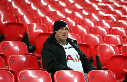 A Tottenham Hotspur fan in the stands prior to the match