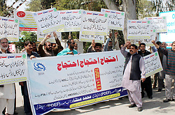 March 29, 2019 - Pakistan - RAWALPINDI, PAKISTAN, MAR 28: Members of Pakistan Diploma Engineers Federation are .holding protest demonstration for acceptance of their demands, at Court road in Rawalpindi on .Thursday, March 28, 2019. (Credit Image: © PPI via ZUMA Wire)