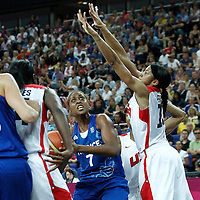 11 August 2012: France Sandrine Gruda looks to pass the ball over  Candace Parker during 86-50 Team USA victory over Team France, during the Women's Gold Medal Game, at the North Greenwich Arena, in London, Great Britain.