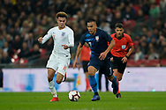 Dele Alli of England puts pressure on Bobby Wood of USA during the International Friendly match between England and USA at Wembley Stadium, London, England on 15 November 2018.