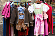 Traditional Tyrolean dirndl dress and lederhosen outfit in shop window  in Hofgasse in Innsbruck, the Tyrol, Austria